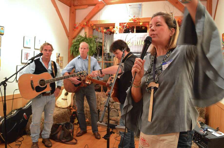 """Alison McDermott of Darien revs up the crowd at the Joshua House Fund's 20th anniversary """"Bluegrass, Bourbon & Blue Jeans"""" party, held at the Darien Nature Center, Saturday, Nov. 4, 2017, in Darien, Conn. Photo: Jarret Liotta / For Hearst Connecticut Media / Darien News Freelance"""