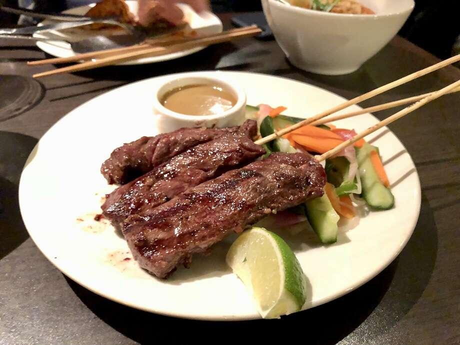 E & O: Steak satay with peanut sauce. Photo: Michael Bauer, The Chronicle