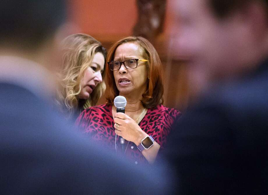 Connecticut state Rep. and the appropriations committee ranking member Melissa Ziobron, R-East Haddam, left, advises state representative Toni Walker, D-New Haven, while Walker answers questions from state Rep. Prasad Srinivasan, R-Glastonbury, during debate on the budget in Hartford. The budget passed 126-23 in a later vote. Photo: Mark Mirko / The Courant Via AP / ©2017 The Hartford Courant