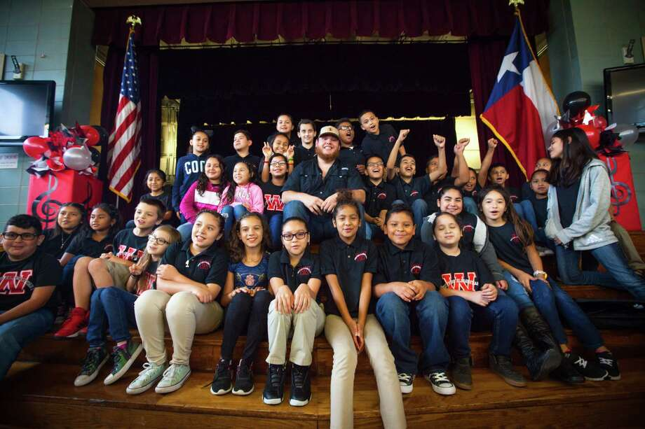 CMA New Artist Of The Year nominee Luke Combs joined the CMA Foundation in Houston to announce the organization's $1 million contribution to Houston Independent School District (HISD) in music education support and resources. Photo: Preston Leatherman