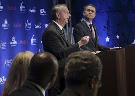 FILE- In this Sept. 19, 2017, file photo, Gubernatorial candidates Republican Ed Gillespie, left, and Democrat Lt. Gov. Ralph Northam debate in McLean, Va. Big names in both major political parties are flocking to Virginia as the state�s closely watched race for governor enters its final days. (Bonnie Jo Mount/The Washington Post via AP, Pool, File)
