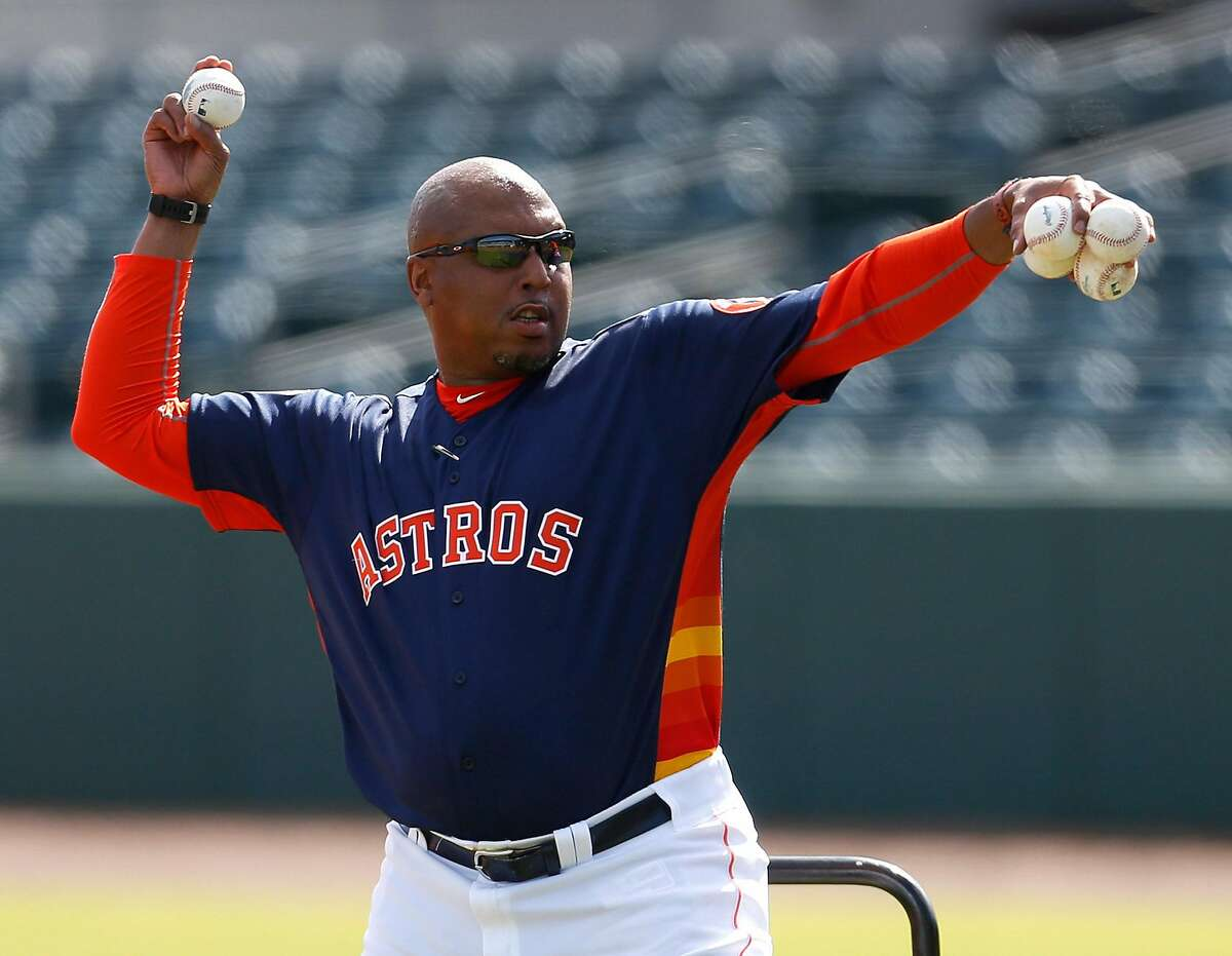 Houston Astros assistant hitting coach Alonzo Powell pitches during batting practice for position players on the main field during spring training in Kissimmee, Florida, Monday, Feb. 22, 2016.( Karen Warren / Houston Chronicle )