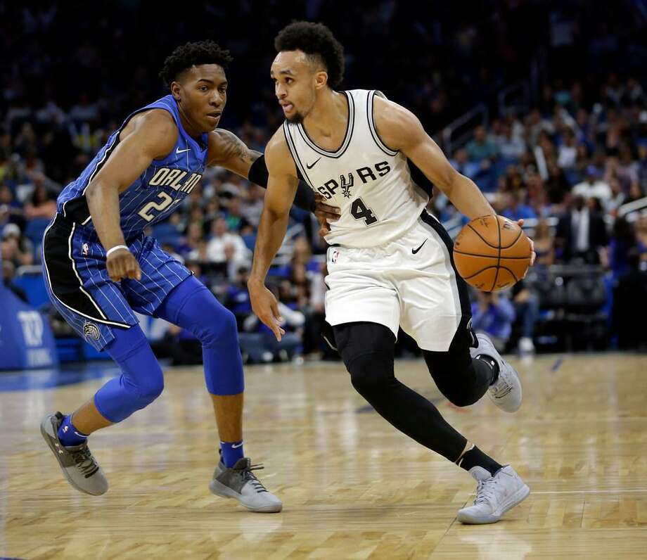 Spurs rookie Derrick White (4) drives around Orlando's Wesley Iwundu during an Oct. 27, 2017 game in Orlando. Photo: /