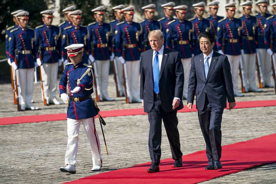 A military honor guard greets President Trump and Japanese Prime Minister Shinzo Abe in Tokyo. Photo: DOUG MILLS, NYT