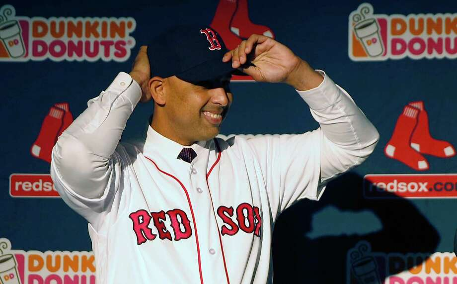 Alex Cora adjusts his baseball cap as he is introduced as the Boston Red Sox baseball teams new manager during a news conference in Boston, Monday, Nov. 6, 2017. (AP Photo/Michael Dwyer) Photo: Michael Dwyer, Associated Press / AP2017