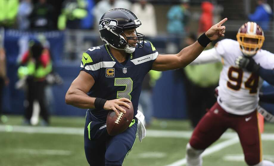 """The MMQB's Gary Gramling """"The Seahawks don't even run an offense anymore,"""" Gramling wrote in his analysis. """"It's the equivalent of a basketball coach who just rolls the ball out and tells his point guard to do whatever (and that's not a criticism of the coaching staff -- when you can't block, can't run, can't protect, your options are limited). Sometimes it works. Against Washington, it didn't."""" Photo: Steve Dykes/Getty Images"""
