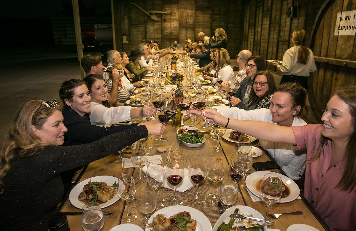 Campers cheers during their final dinner together at Dutton Ranch in Sebastopol.