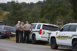 NEW BRAUNFELS, TX - NOVEMBER 6: Comal County Sheriff deputies at the front gate to the home and property of Devin P. Kelley November 6, 2017 near New Braunfels, Texas. Kelley was the alledged gunman that killed at least 26 people and as many as 20 injured in mass shooting at First Baptist Church in Sutherland Springs, Texas. (Photo by Erich Schlegel/Getty Images)