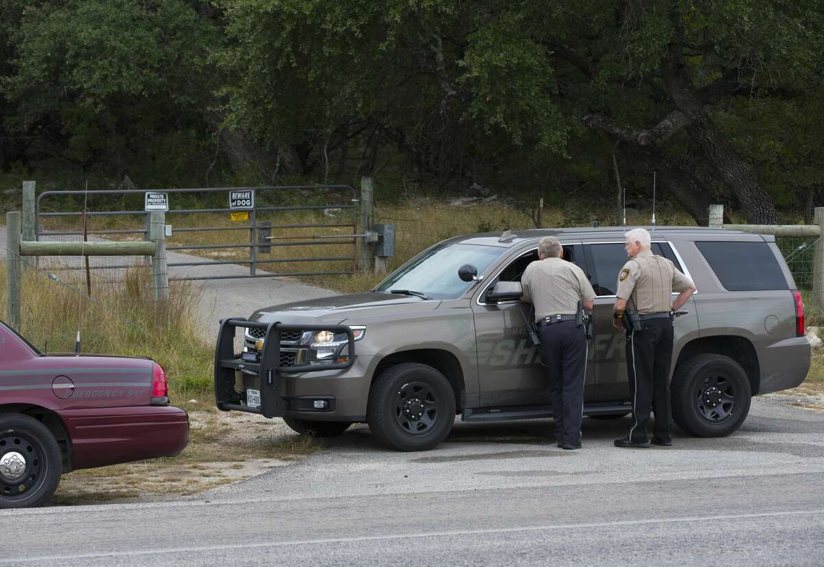 Comal County Sheriff deputies at the front gate to the home and property of Devin P. Kelley November 6, 2017 near New Braunfels, Texas. Kelley was the alleged gunman that killed at least 26 people and as many as 20 injured in mass shooting at First Baptist Church in Sutherland Springs, Texas.