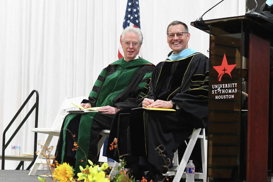 Chairman of the University of St. Thomas Board of Directors Dr. Herbert Edmundson, Jr., '69, M.D., Ph.D (left) with University of St. Thomas 9th President Dr. Richard L. Ludwick, J.D., D.Ed. at the installation ceremony held on Oct. 27 on campus. During the installation ceremony, Dr. Edmundson charged the president to execute faithfully on the mission set forth by the University founders, the Basilian Fathers. Photo: Daniel Perez / DANIELORTIZPHOTOGRAPHY