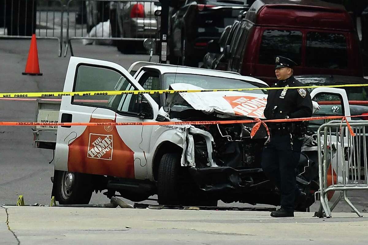 A police officer walks past the wreckage of a Home Depot pickup truck, a day after it was used in a terror attack, in New York on November 1, 2017. (JEWEL SAMAD/AFP/Getty Images) ORG XMIT: MER2017110110480954