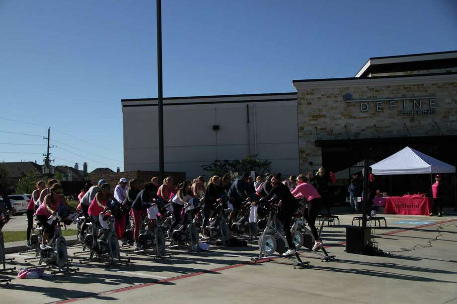 """DEFINE Katy fitness studio recently hosted a fundraising """"Pink Ride"""" cycle class to benefit cancer patients at Houston Methodist Cancer Center at West. Photo: Courtesy Photo"""