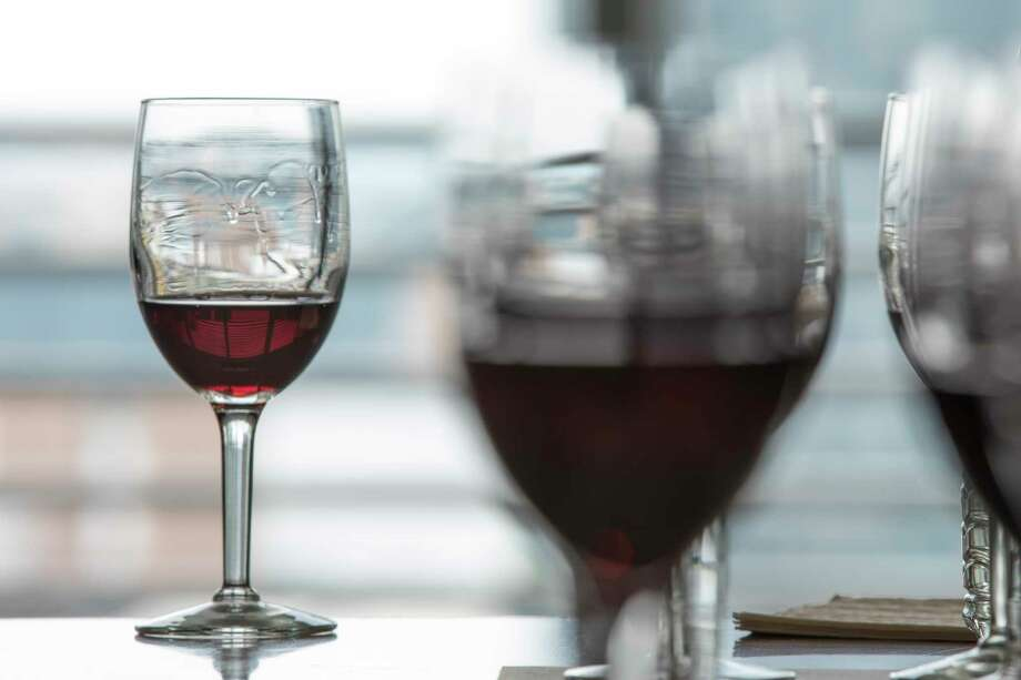 A glass of Valpolicella, the youthful red from from Italy's Veneto region, at a tasting in New York, Aug. 4, 2017. Though much of the region's grapes are now reserved for more potent Amarones and Ripassos, plain old Valpolicella remains a quintessentially  refreshing Italian red, balancing the flavors of sweet cherry fruit with a tart, earthy quality. (Tony Cenicola/The New York Times) Photo: TONY CENICOLA, STF / NYTNS