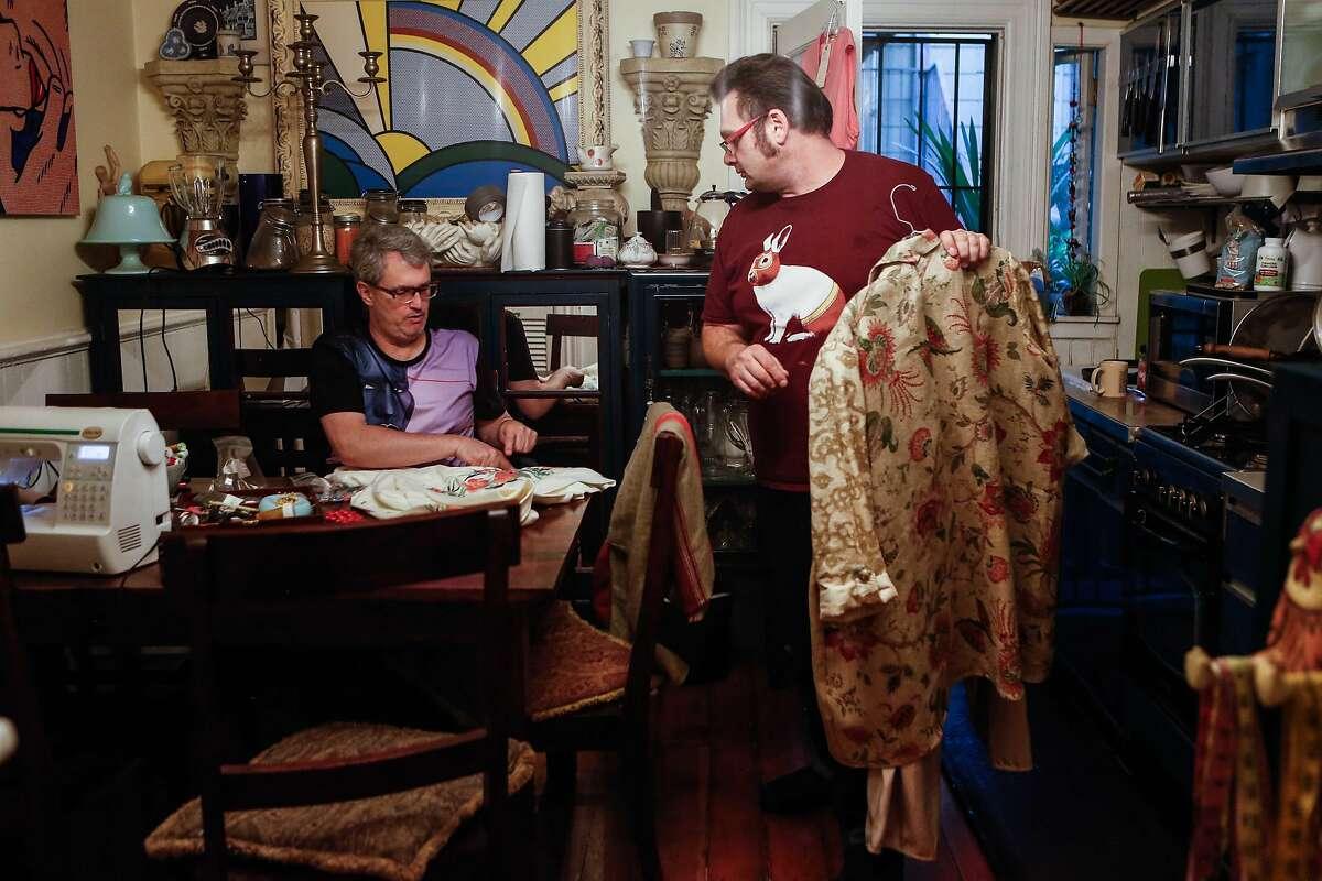 "Glenn Krumbholz (right) and John Blair work on the costumes for ""The Golden Girls: The Christmas Episodes - 2017"" in Krumbholz's home in San Francisco."