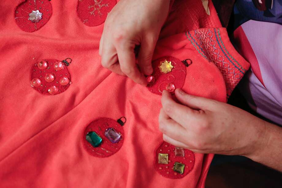 """John Blair puts the final touches on the costumes for """"The Golden Girls: The Christmas Episodes."""" Photo: Amy Osborne, Special To The Chronicle"""