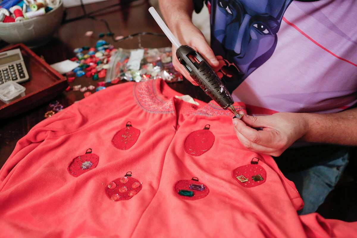 John Blair uses a glue gun to complete the final touches on the costumes for The Golden Girls: The Christmas Episodes - 2017 in Glenn Krumbholz's home on Saturday, October 28, 2017 in San Francisco, Calif.