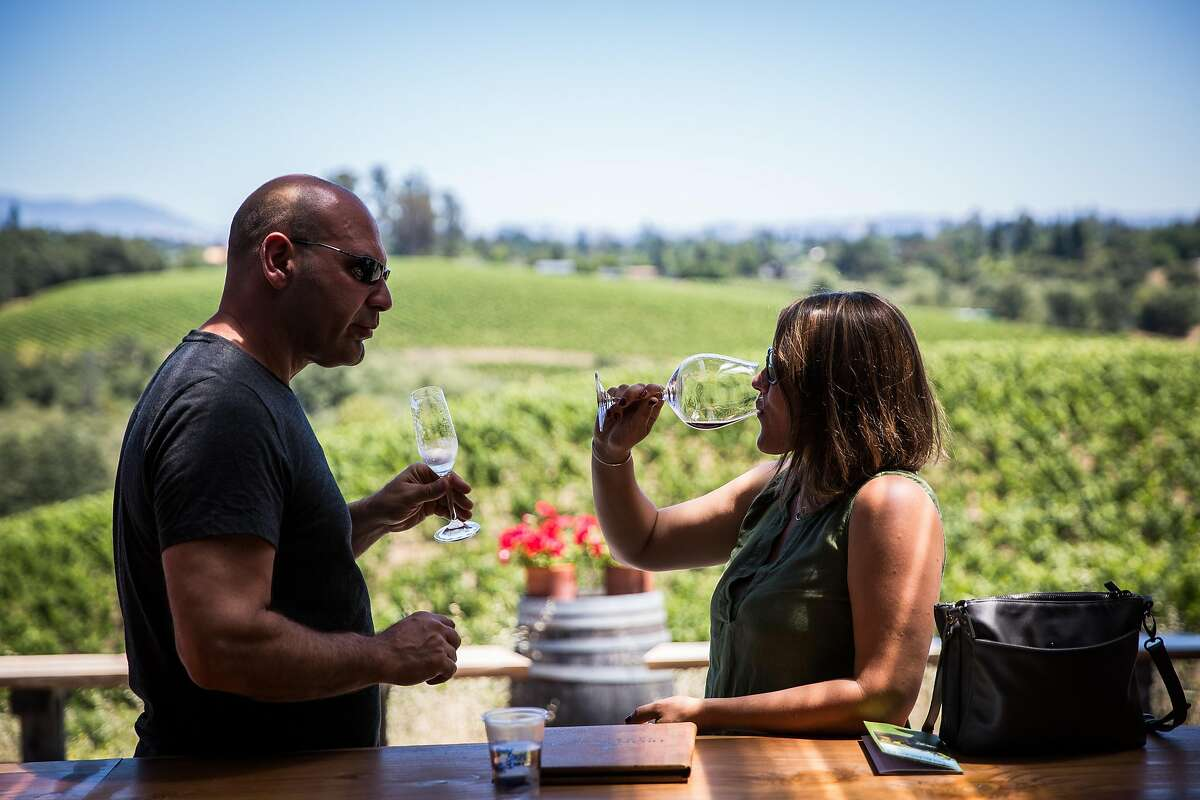 Anthony Palmieri, left, and Kristyn Bogli, both of Boston taste wine at Iron Horse Vineyards in Sebastopol, California on July 6, 2017.