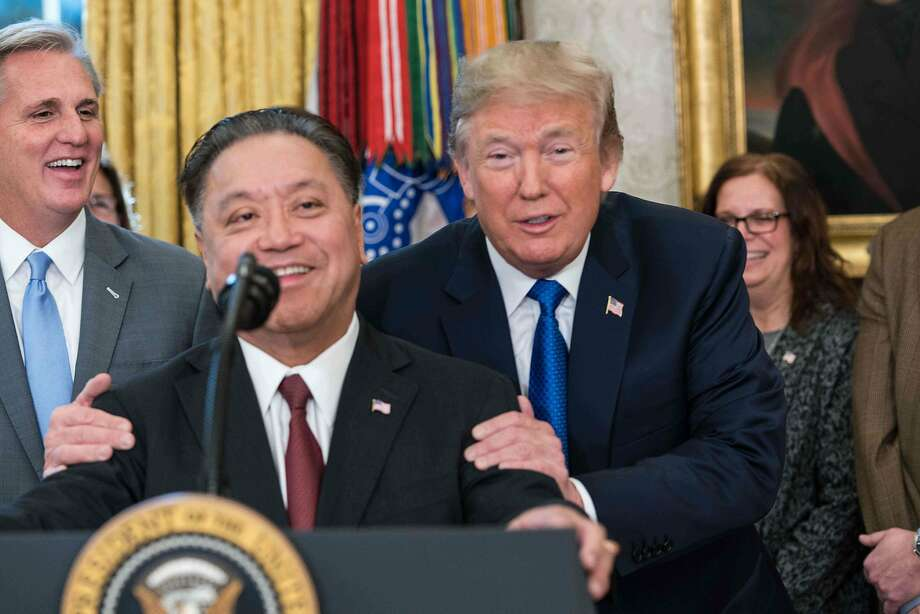 President Trump jokes with Broadcom CEO Hock Tan about the company moving back to the U.S. Photo: NICHOLAS KAMM, AFP/Getty Images