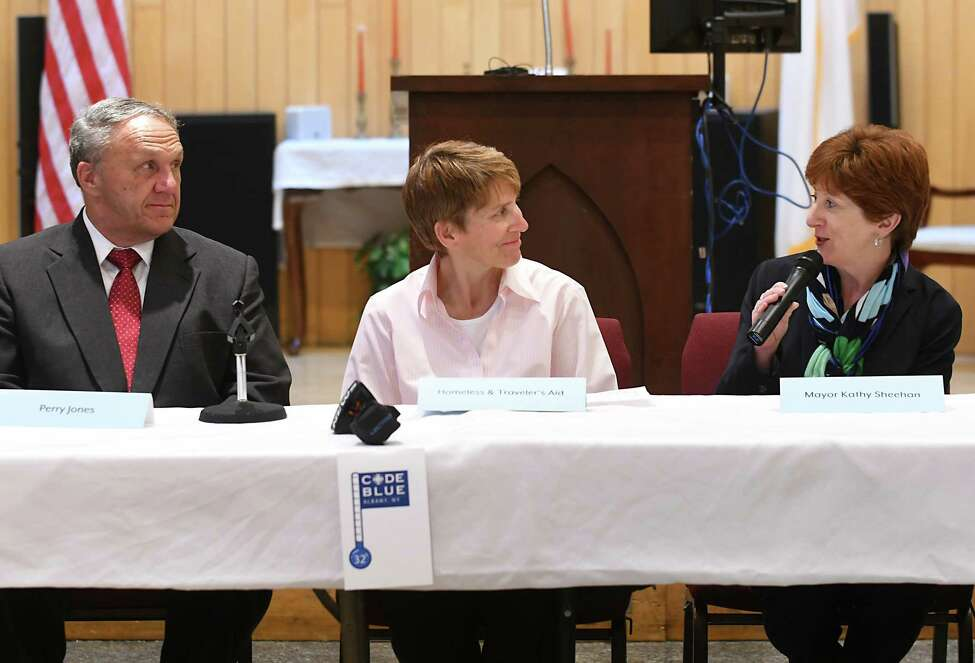 Perry Jones, Capital City Rescue Mission Executive Director, left, Liz Hitt, executive director for Homeless and Traveler's Aid, center, and Albany Mayor Kathy Sheehan talk about the Code Blue program during a press conference at the Capital City Rescue Mission on Monday, Nov. 6, 2017 in Albany, N.Y. (Lori Van Buren / Times Union)