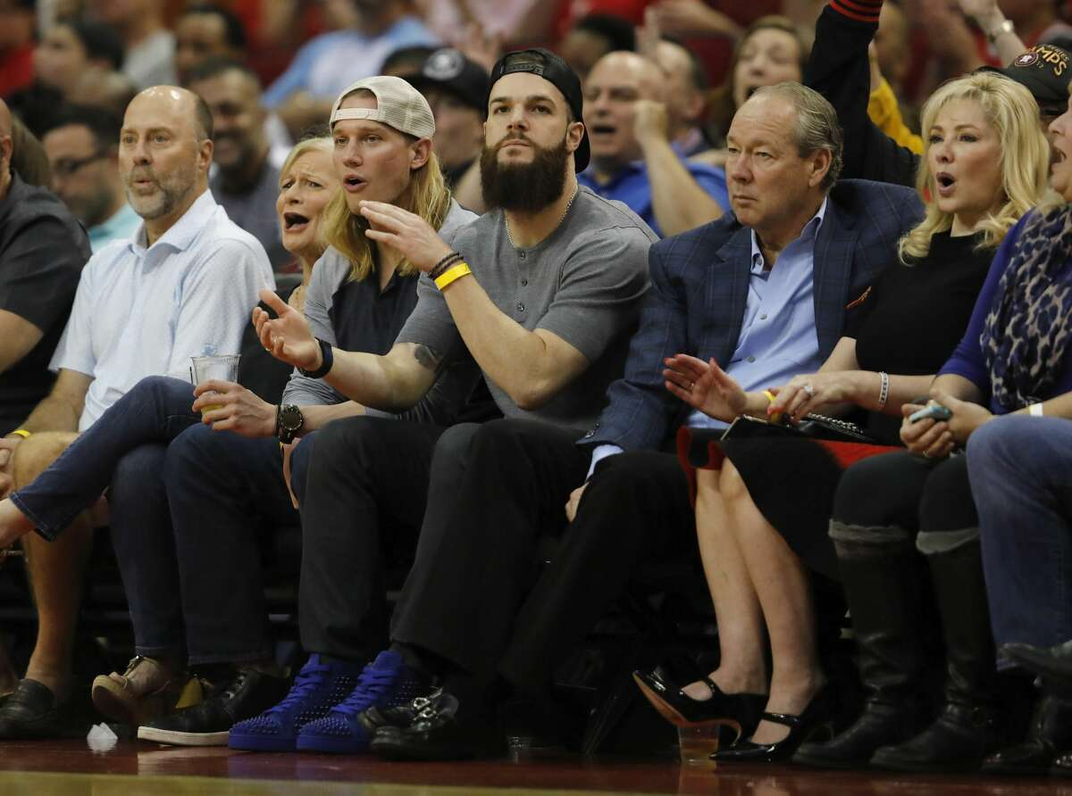 HOUSTON, TX - NOVEMBER 05: Dallas Keuchel of the Houston Astros and Astros owner Jim Crane watch the first half of the game between the Houston Rockets and the Utah Jazz at Toyota Center on November 05, 2017 in Houston, Texas. NOTE TO USER: User expressly acknowledges and agrees that, by downloading and or using this photograph, User is consenting to the terms and conditions of the Getty Images License Agreement. (Photo by Tim Warner/Getty Images)