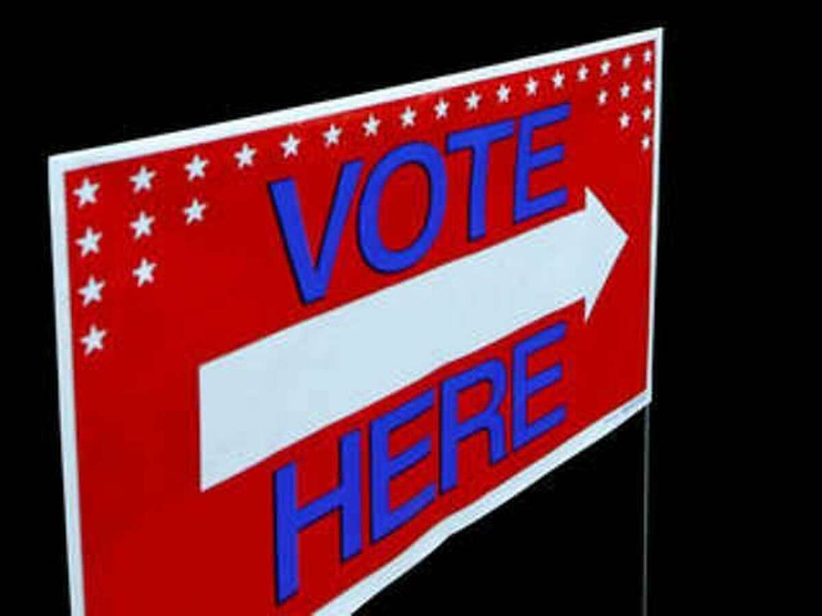 A sign directing voters to the polls