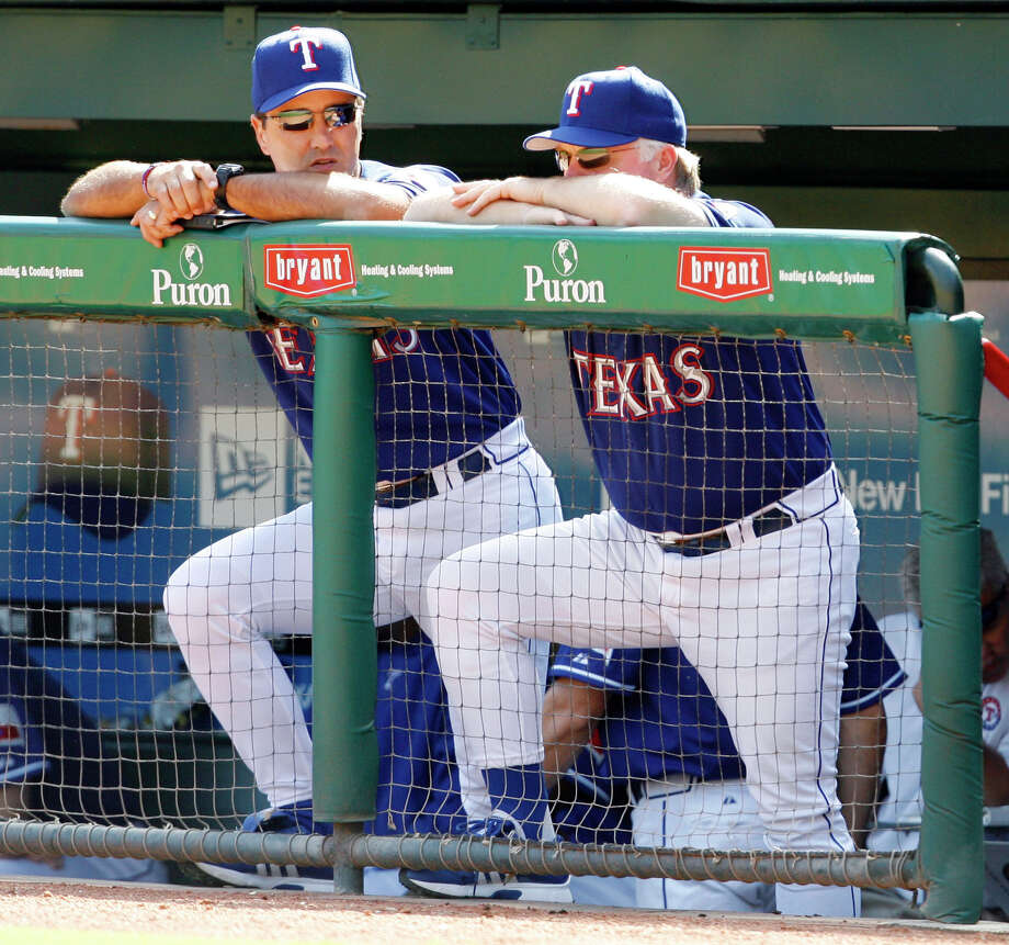 Texas Rangers manager Buck Showalter, right, and bench coach Don Wakamatsu watch from the dugout as the Rangers lose to the Cleveland Indians, 11-6, in their final home game of the season, Sunday, Sept. 24, 2006, in Arlington, Texas. Showalter was fired as manager of the Texas Rangers on Wednesday, ending four seasons in which he was never able to get a team with several young All-Stars above third place in the AL West. (AP Photo/Matt Slocum)
