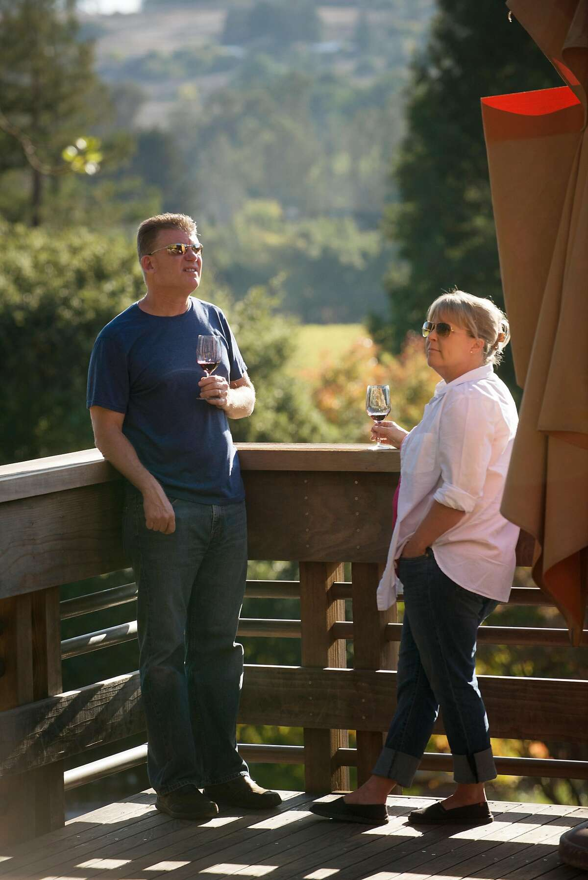 Tom Young, left, and Joanna Young of Penngrove, California out on the deck near the tasting room at Matanzas Creek Winery in Santa Rosa on November 5, 2017.