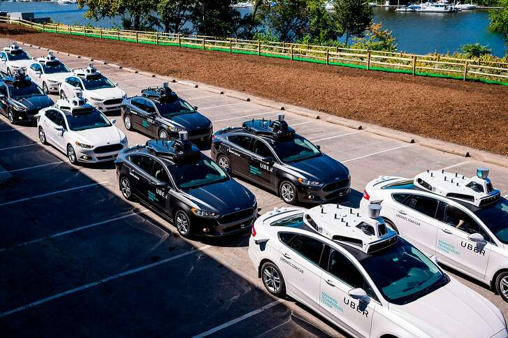 (FILES) This file photo taken on September 13, 2016 shows pilot models of the Uber self-driving car on display at the Uber Advanced Technologies Center in Pittsburgh, Pennsylvania. Uber on October 27, 2017 said it has hired a new top legal officer as the ride-sharing star battles controversy in the workplace as well as on the streets. Tony West will begin working at San Francisco-based Uber next month, leaving a post as chief legal officer at Pepsi, Uber chief executive Dara Khosrowshahi said in an email to employees, a copy of which was obtained by AFP. / AFP PHOTO / Angelo MerendinoANGELO MERENDINO/AFP/Getty Images