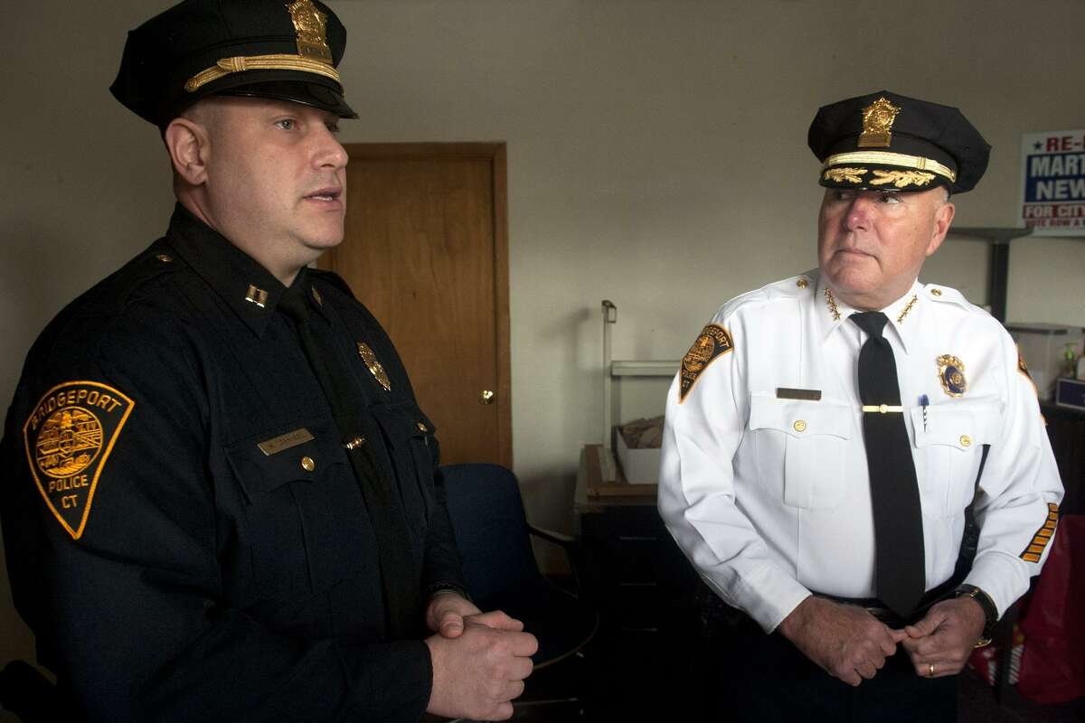 """Police Captain Mark Straubel, left, and Chief Armando ?""""A.J.?"""" speak at the site of an new police substation that will soon open in Bridgeport, Conn. Nov. 6, 2017."""