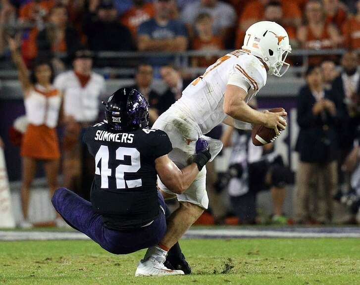 TCU's Ty Summers sacks Texas quarterback Shane Buechele during the Horned Frogs' victory at Amon G. Carter Stadium on Nov. 4, 2017 in Fort Worth, Texas.