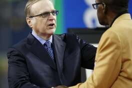 Seahawks owner Paul Allen greets NFL Hall of Fame member and former Seahawk Kenny Easley as his number is retired during halftime of the game between the Seattle Seahawks and Indianapolis Colts at CenturyLink Field on October 1, 2017 in Seattle, Washington. (Photo by Otto Greule Jr/Getty Images)