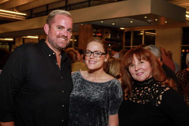 Jonathan Bietler, from left, Emily Jaschke and Elaine Dillard at Sunday Supper. The event is hosted by chef Richard Kaplan and Weights + Measures, and will benefit the Urban Harvest Market program.