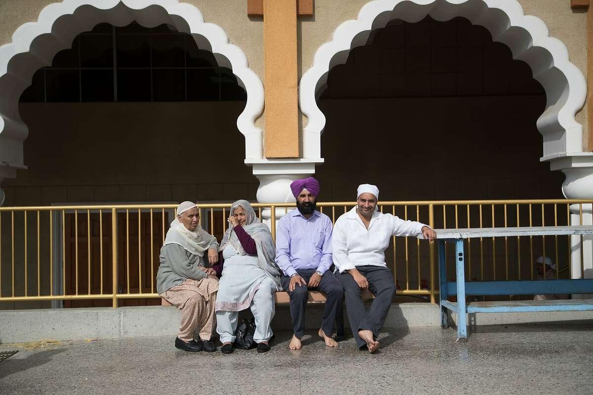 Rurdev Kaur and Kuldip Kaur, Bhupiinder Singh Cheema and Dr. Dalvir Singh Pannu at Gurdwara, an Indian temple on Sunday, Oct. 29, 2017 in San Jose, Calif.