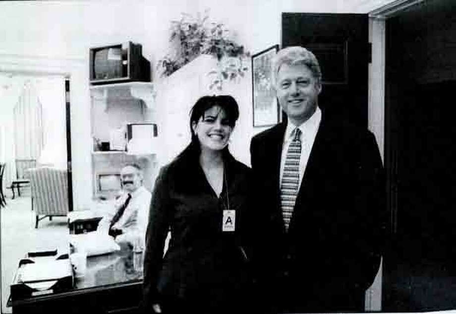 This photo of former White House intern Monica Lewinsky meeting President Bill Clinton at a White House function was submitted as evidence in documents by the Starr investigation and released by the House Judiciary committee in 1998. It is not a far leap to suppose that Clinton's excesses influenced today's sexual harassment climate. Photo: /