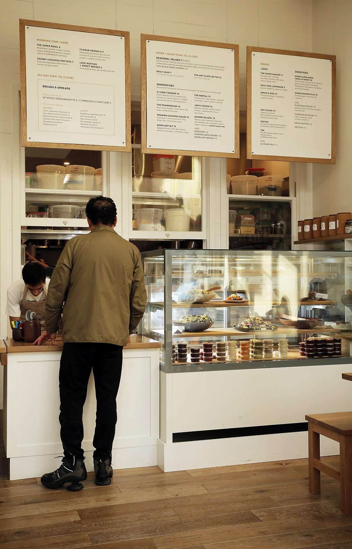 A customer orders food at Seed + Salt in San Francisco, Calif., on Sunday, January 4, 2015. Seed + Salt is a new breakfast-lunch restaurant in the Marina with vegan and gluten-free food, heavy on the vegetables and whole grains.