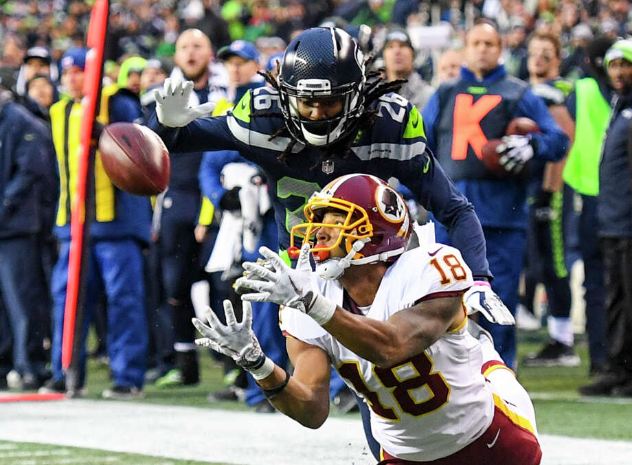 Washington Redskins wide receiver Josh Doctson (18) hauls in a pass on the 1-yard line against Seattle Seahawks cornerback Shaquill Griffin (26) setting up the game-winning touchdown at CenturyLink Field. Photo: The Washington Post/The Washington Post/Getty Images