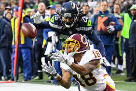 Washington Redskins wide receiver Josh Doctson (18) hauls in a pass on the 1-yard line against Seattle Seahawks cornerback Shaquill Griffin (26) setting up the game-winning touchdown at CenturyLink Field.