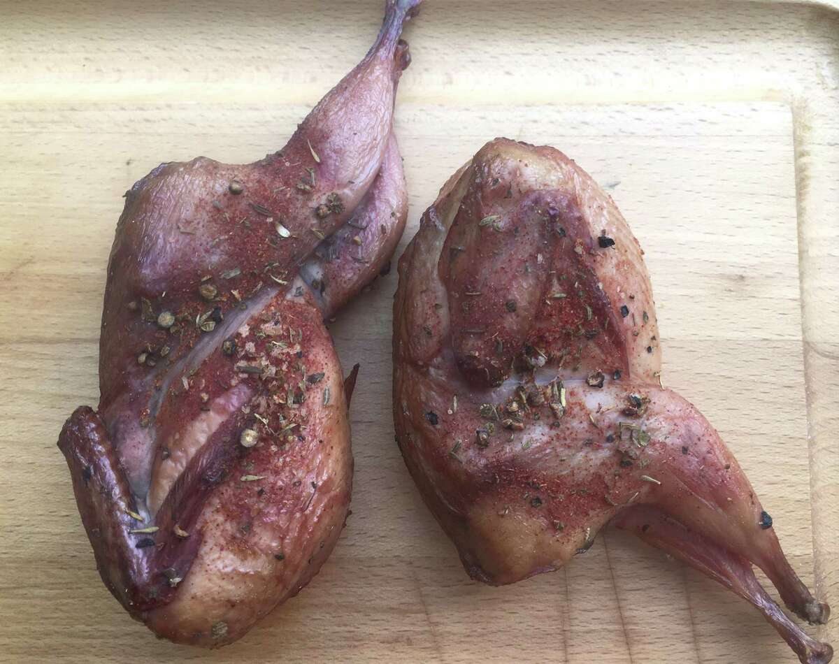 Chile-rubbed Smoked Quail. Quail take well to the smoker, finishing in under the hour. Since the body cavity is split open, smoke permeates throughout the bird.
