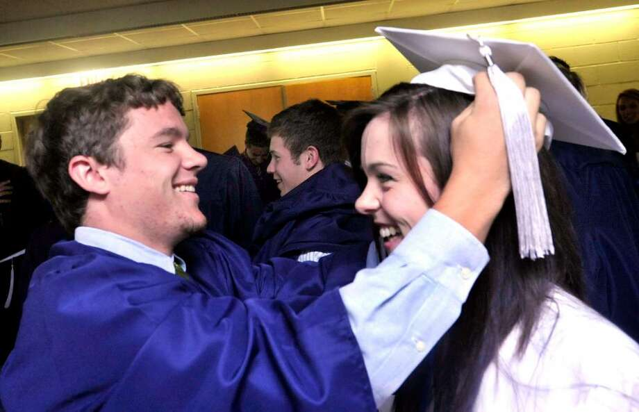 Brian Bacan adjusts Megan Heffernan's cap at New Fairfield High School commencement exercises at the William O'Neill Convocation Center in Danbury, on Saturday, June 26, 2010. Photo: Michael Duffy / The News-Times