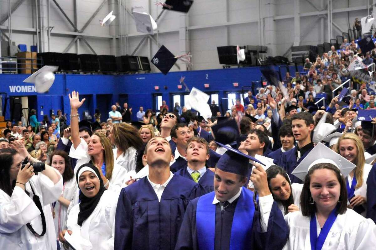 Graduates toss their caps at the close of New Fairfield High School commencement exercises at the William O'Neill Convocation Center in Danbury, on Saturday, June 26, 2010.