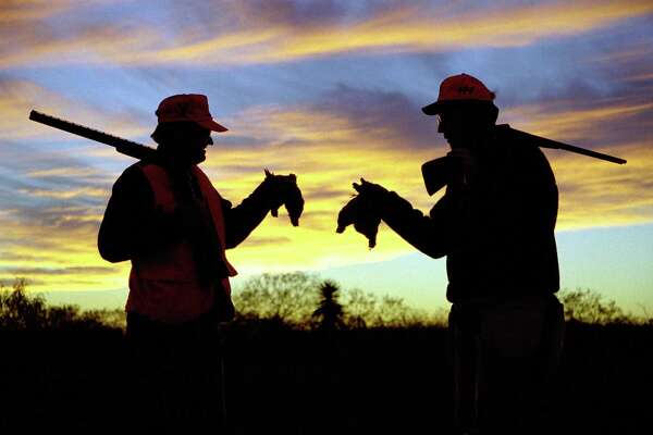Two quail hunters silhouette against the sky in South Texas. Quail and dove hunting is extremely popular in Texas.