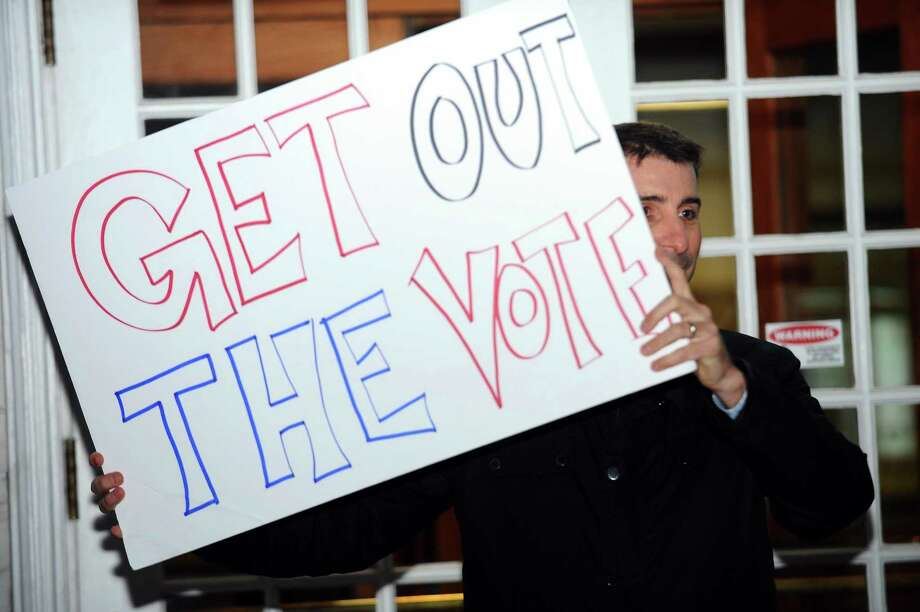 Marc Bradley holds a sign encouraging people to vote during the non-partisan get out the vote rally in front of Greenwich Town Hall in Greenwich, Conn. on Monday, Nov. 6, 2017. Photo: Michael Cummo / Hearst Connecticut Media / Stamford Advocate