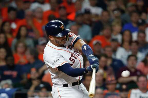 Houston Astros shortstop Carlos Correa gets a hit last month during the team's championship run.