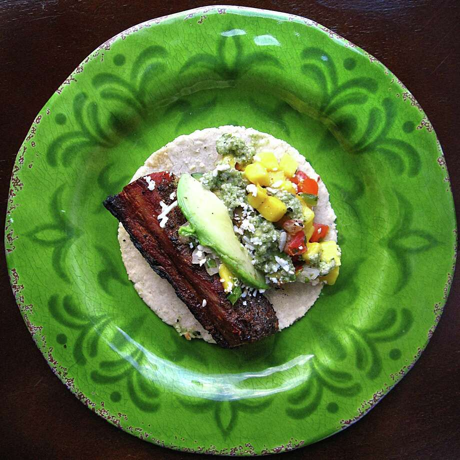 Pork belly taco with mango pico de gallo on a handmade corn tortilla from Sangria on the Burg. Photo: Mike Sutter /San Antonio Express-News