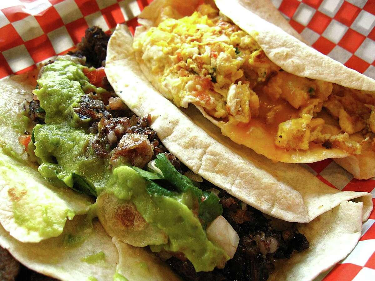 Cabeza taco with avocado and pico de gallo, left, and an egg and cheese taco with pico de gallo, both on flour tortillas, from Vaqueros Mexican Food.