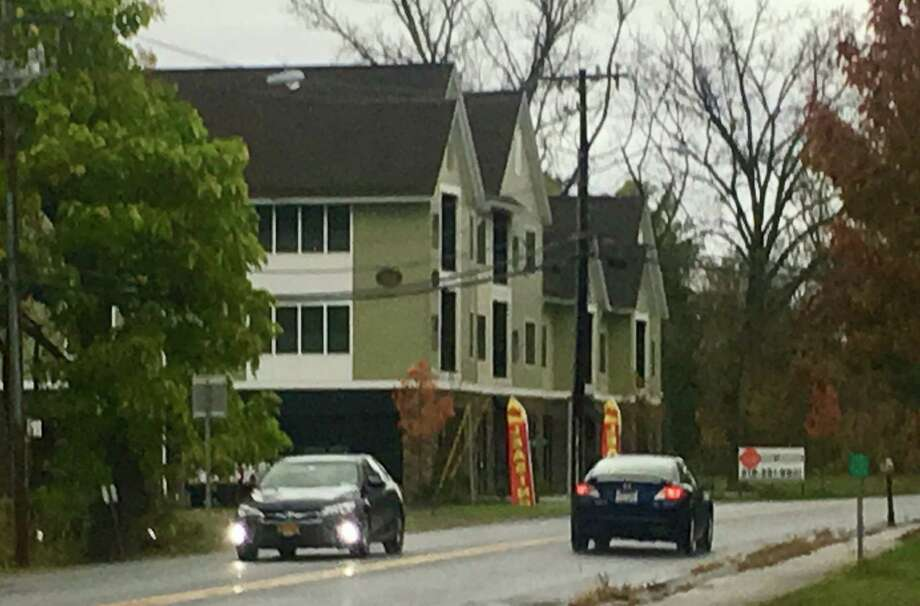 The owners of the Hamlet at Slingerlands want to put in a parking lot to the right of this apartment building that faces New Scotland Road. The parking would serve first floor commercial space that is currently vacant but could include a coffee shop or wine bar in the future.