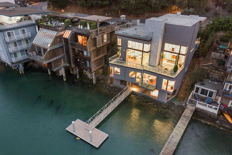 2070 Paradise Drive is a newly built, four-bedroom smart home with a private dock.  Photo: Open Homes Photography