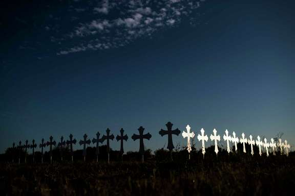 26 crosses honoring the victims of the shooting that occurred on Sunday in the First Baptist Church of Sutherland Springs have been placed, Monday, Nov. 6, 2017, in Sutherland Springs.