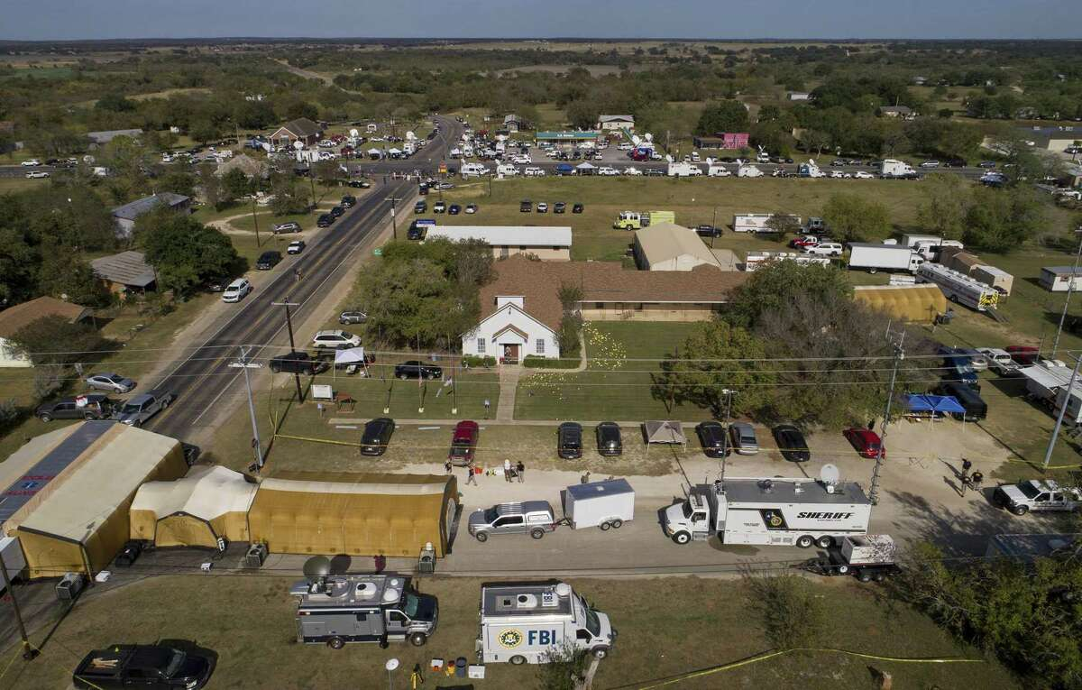 Investigators work at the First Baptist Church in Sutherland Springs, Texas, Monday, Nov. 6, 2017, the day after over 20 people died in a mass shooting Sunday. (Jay Janner/Austin American-Statesman via AP)