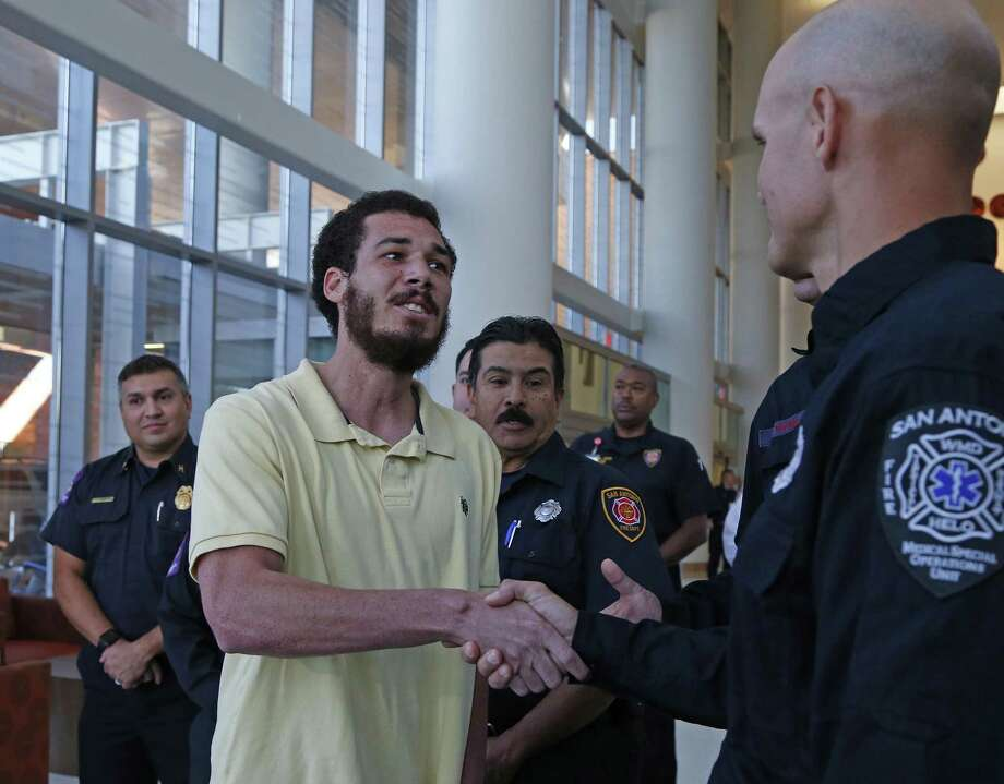 Tobias Walker thanks first responders, including Kip Hanson, for their actions in saving his life. Photo: Ron Cortes /For The San Antonio Express-News